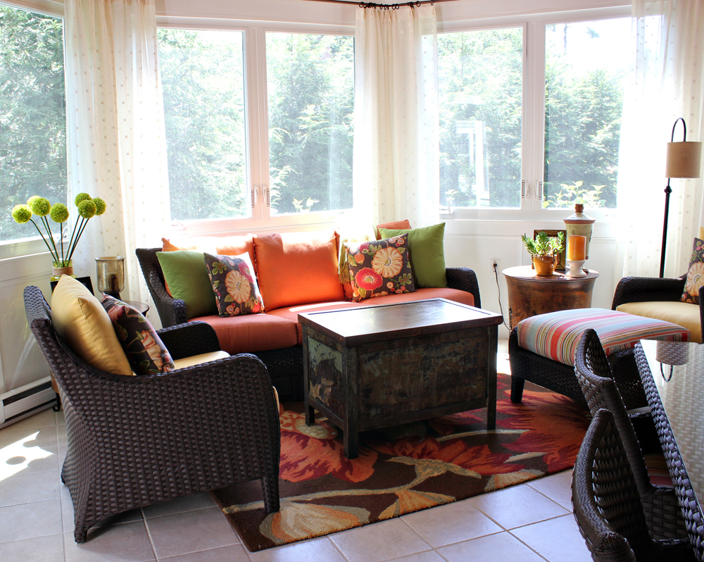 cheerful sunroom with wicker furniture